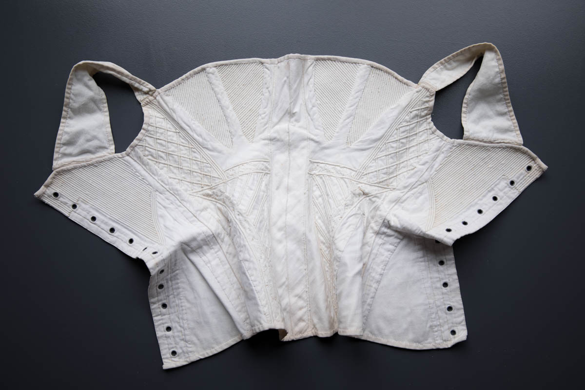 Hand Stitched, Corded & Embroidered White Cotton Corset, c. 1830-1840s. The Underpinnings Museum. Photography by Tigz Rice