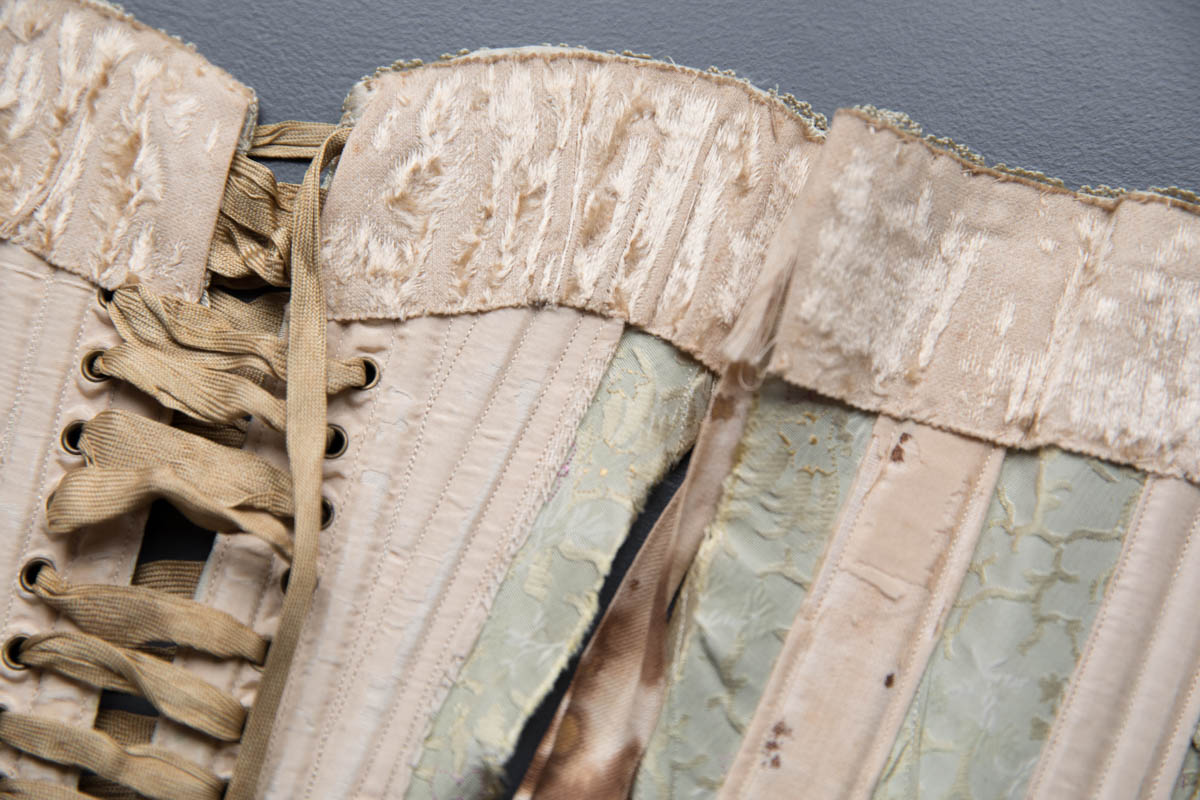 Silk Brocade Midbust Corset With Ribbonslot Crochet Lace Trim, c. 1900s. The Underpinnings Museum. Photography by Tigz Rice